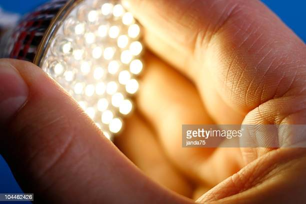 led light in hand - lighting equipment stock photos and pictures
