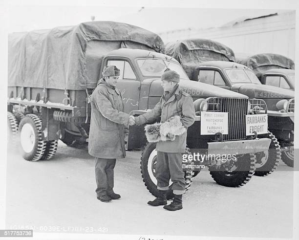 Led Truck Convoy to Alaska Fairbanks Alaska Lt Fred MacLean congratulates the driver of the leading vehicle of the truck convoy which was the first...
