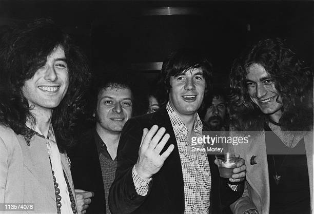 Led Zeppelin guitarist Jimmy Page comedian Bill Minkin comedian Michael Palin and Led Zeppelin singer Robert Plant attending a Monty Python party in...