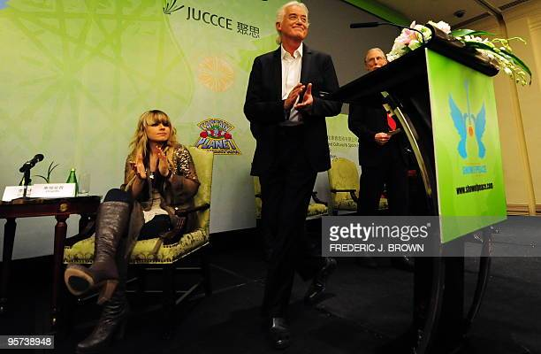 Led Zeppelin guitarist Jimmy Page takes the stage as guitarist for the late Michael Jackson Orianthi looks on during a press conference in Beijing on...