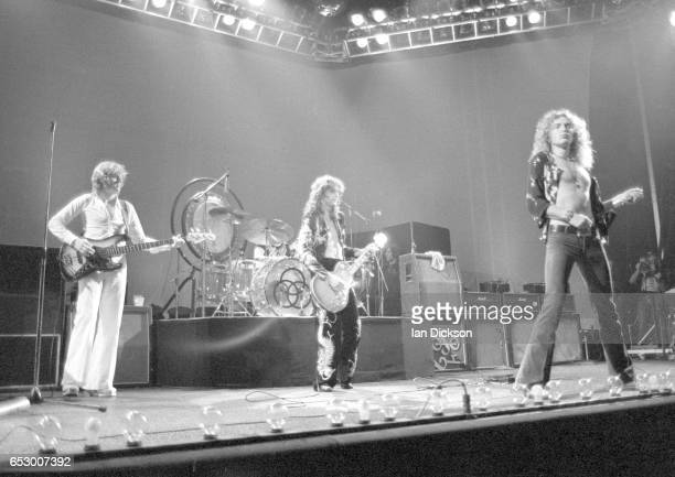 Led Zeppelin performing on stage at Earls Court London 17 May 1975 LR John Paul Jones Jimmy Page and Robert Plant