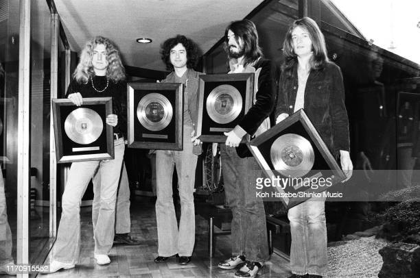 Led Zeppelin, receiving gold discs after a press coference at Tokyo Hilton Hotel, Tokyo, Japan, 30th September 1972. L-R Robert Plant, Jimmy Page,...
