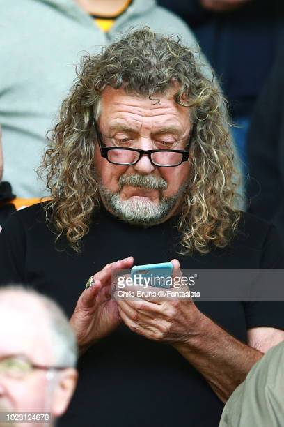 Led Zeppelin singer Robert Plant looks on during the Premier League match between Wolverhampton Wanderers and Manchester City at Molineux on August...