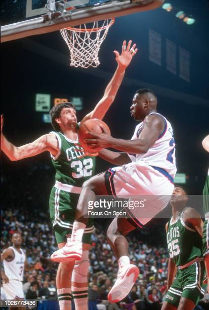 Ledell Eackles of the Washington Bullets drives on Kevin McHale of the Boston Celtics during an NBA basketball game circa 1991 at the Capital Centre...