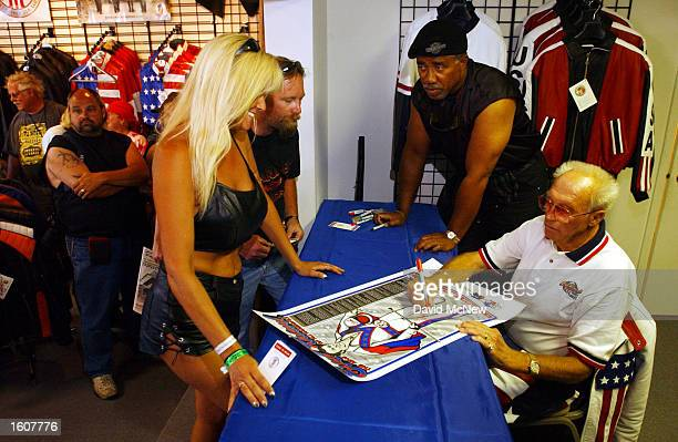 Ledendary motorcycle stuntman Evel Knievel signs a poster at the 61st annual Sturgis Motorcycle Rally August 9 in Sturgis SD