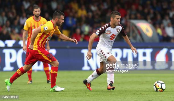Ledian Memushaj of Benevento competes for the ball with Iago Falque of Torino during the Serie A match between Benevento Calcio and Torino FC at...