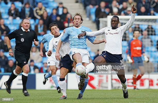 Ledley King and Michael Brown of Spurs battle with Paul Bosvelt of Man City during the FA Cup Fourth Round match between Manchester City and...