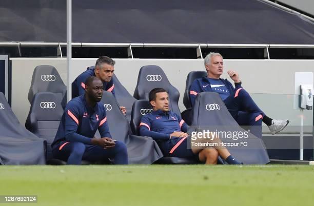 Ledley King, Nuno Santos, Joao Sacramento and Jose Mourinho, Head Coach of Tottenham Hotspur on the bench during the pre-season friendly match...