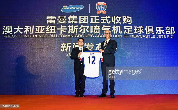 July 06: Ledman Group chairman Martin Lee and David Gallop, chief executive officer of Football Federation Australia, pose for a photo during the...