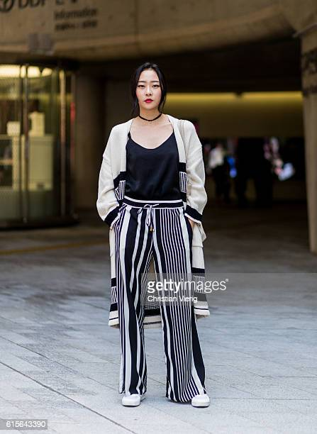 Lee A Rim wearing a black white stripped pants and coat on October 19 2016 in Seoul South Korea
