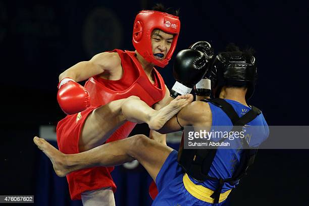 Lee Aik Hong of Singapore fights Ko Chit Ko of Myanmar in the wushu men's sanda 60kg at the Expo Hall 2 during the 2015 SEA Games on June 6 2015 in...