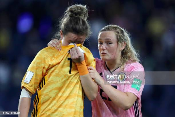 Lee Alexander is consoled by Erin Cuthbert of Scotland following the 2019 FIFA Women's World Cup France group D match between Scotland and Argentina...