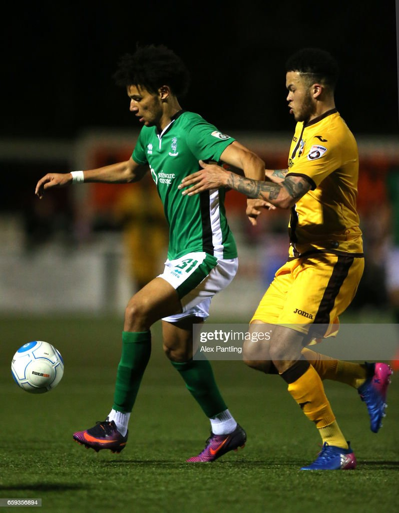 Lee Angol of Lincoln City holds off Louis John of Sutton united during the Vanarama National League match between Sutton United and Lincoln City at Gander Green Lane on March 28, 2017 in Sutton, Greater London.