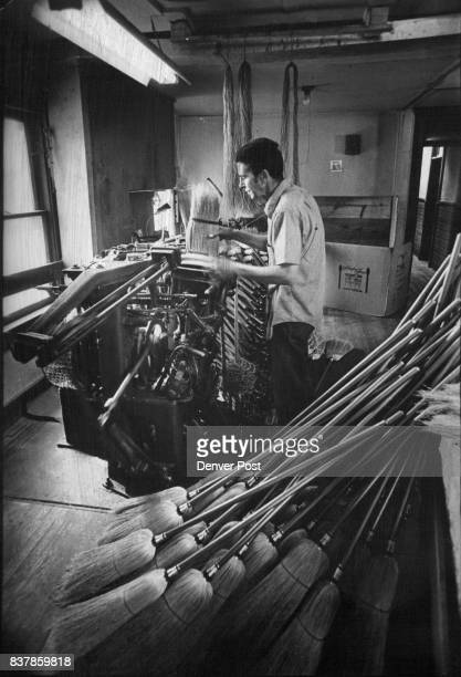 """Lee Aquitar employe at shop about 18 years runs giant sewing machine"""" that noisily stitches brooms Credit Denver Post"""