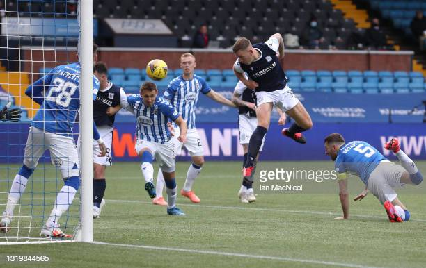 Lee Ashcroft of Dundee heads in the second Dundee goal during the Scottish Premiership Playoff Final 2nd Leg between Kilmarnock and Dundee at Rugby...