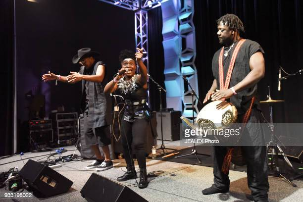 Lee Bass Gata Misteriosa and Assane of Gato Preto perform onstage at International Day Stage during SXSW on March 17 2018 in Austin Texas