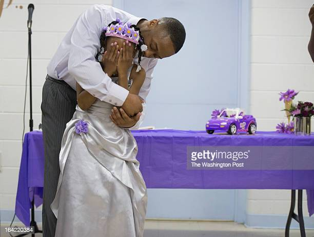 Lee Bassett hugs his daughter Shavondra Harkless after she freestyle rapped for her father during the second annual Date with Dad event at the...
