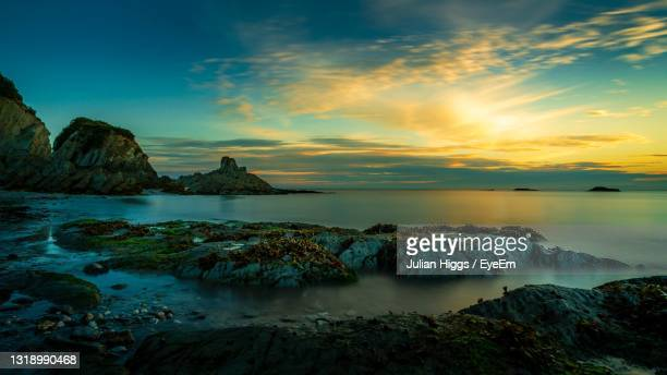 lee bay sunrise - ilfracombe stock pictures, royalty-free photos & images