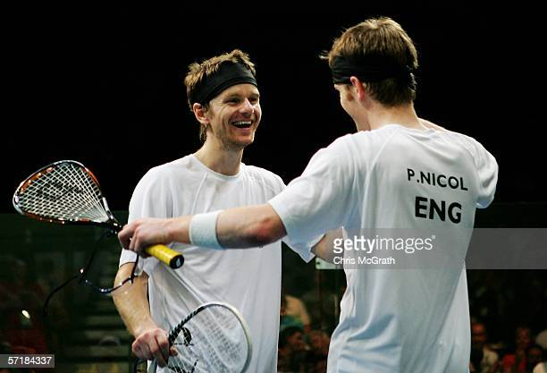 Lee Beachill and Peter Nicol of England celebrate their victory over Stewart Boswell and Anthony Ricketts of Australia in their men's Doubles Gold...