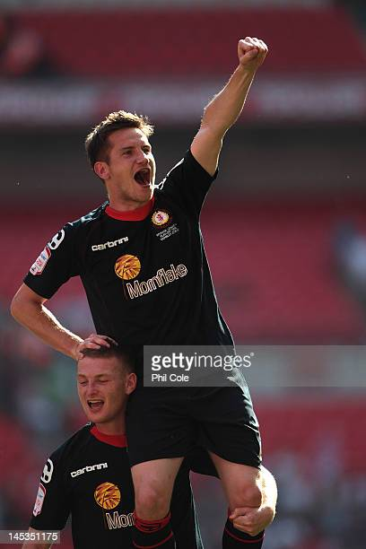 Lee Bell is caried by Adam Bungle of Crewe Alexandra after winning the npower League two playoff final between Cheltenham Town and Crewe Alexandra at...