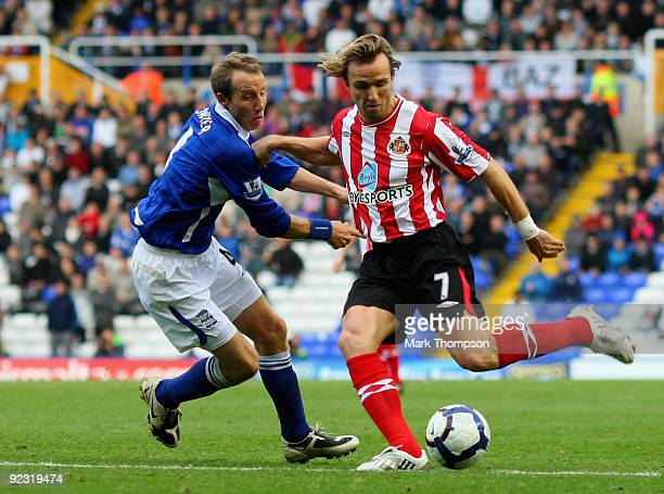 Lee Bowyer of Birmingham City tangles with Bolo Zenden of Sunderland during the Barclays Premier League match between Birmingham City and Sunderland...