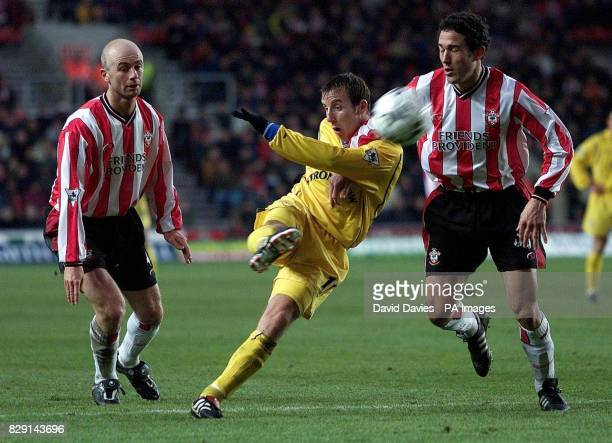 Lee Bowyer of Leeds United shoots under pressure from Paul Telfer and Chris Marsden of Southampton during their FA Barclaycard Premiership match at...