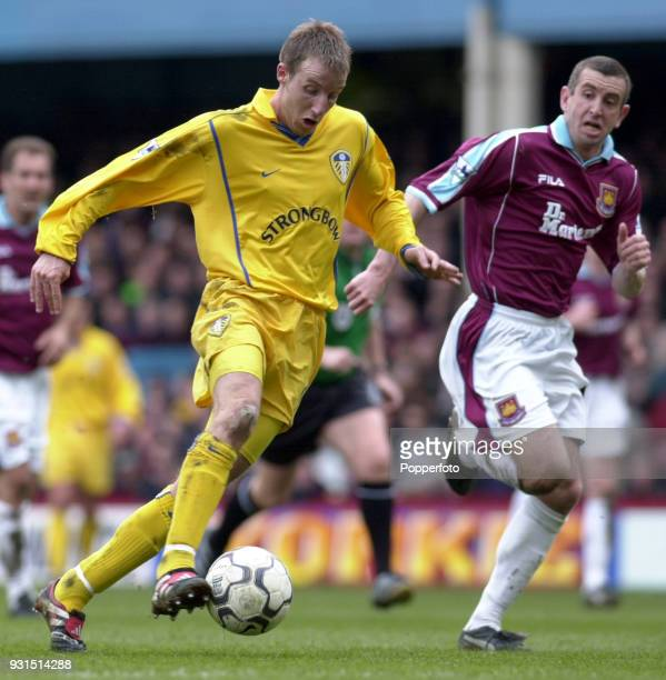 Lee Bowyer of Leeds United takes on Nigel Winterburn of West Ham United during the FA Carling Premiership match between West Ham United and Leeds...