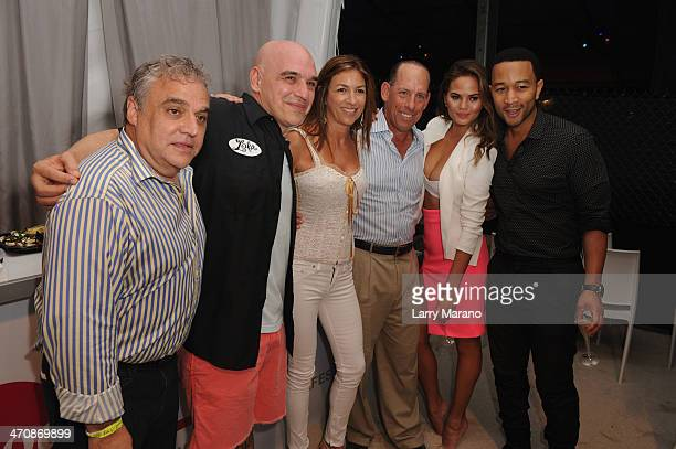 Lee Brian Schrager chef Michael Symon Arlene Chaplin Wayne E Chaplin Chrissy Teigen and John Legend attend Moet Hennessy's The Q presented by...