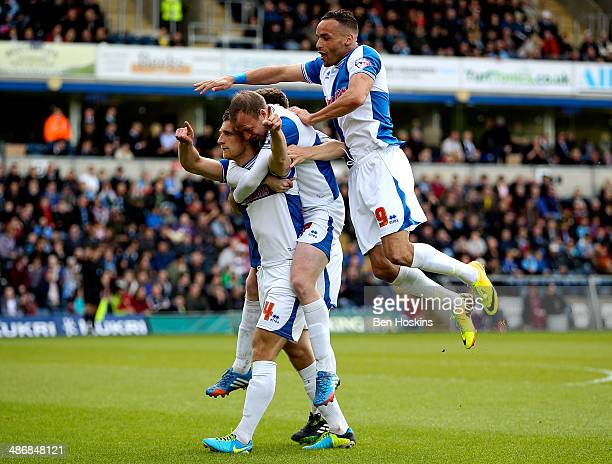 Lee Brown of Bristol celebrates with team mates after scoring the opening goal of the game during the Sky Bet League Two match between Wycombe...