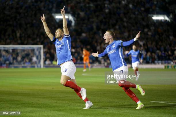 Lee Brown of Portsmouth FC celebrates after he scores a goal to make it 1-0 with team-mate Ronan Curtis during the Sky Bet League One match between...