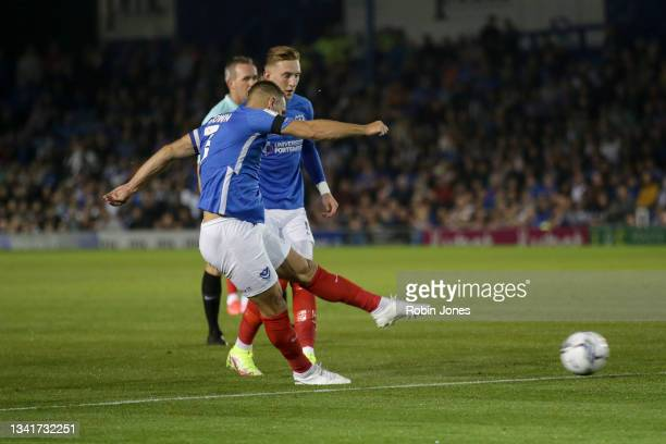 Lee Brown of Portsmouth FC scores a goal to make it 1-0 from a free-kick during the Sky Bet League One match between Portsmouth and Plymouth Argyle...