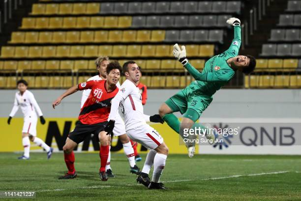 Lee Bumsoo of Gyeongnam dives in vain as Song Juhun of Gyeongnam scores an own goal during the AF Champions League Group E match between Gyeongnam...