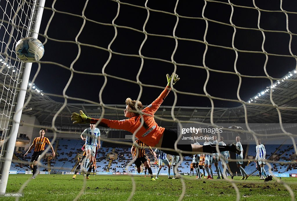 Lee Burge of Coventry City fails to save the shot from Mark Yeates during the Sky Bet League One match between Coventry City and Bradford City at Ricoh Arena on March 10, 2015 in Coventry, England.