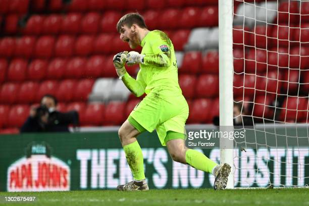 Lee Burge of Sunderland celebrates after saving the penalty of Remy Howarth of Lincoln City during the Papa John's Trophy Semi-Final match between...