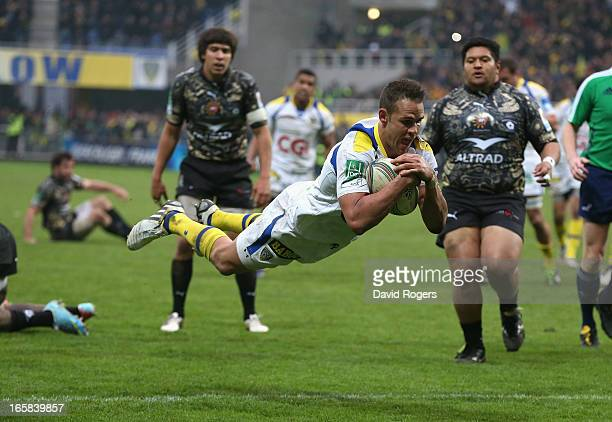 Lee Byrne of Clermont Auvergne dives to score a try during the Heineken Cup quarter final match between Clermont Auvergne and Montpellier at Stade...