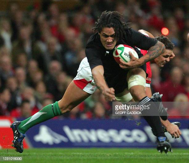 Lee Byrne of Wales tackles Rodney So'oialo of the All Blacks during the Invesco Challenge rugby union internatonal match between Wales and New...