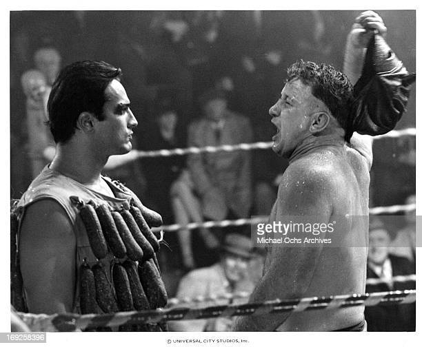 Lee Canalito facing off against another in the ring in a scene from the film 'Paradise Alley' 1978