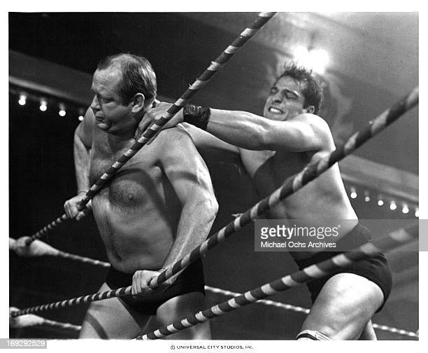 Lee Canalito shoving opponent into the ropes in a scene from the film 'Paradise Alley' 1978