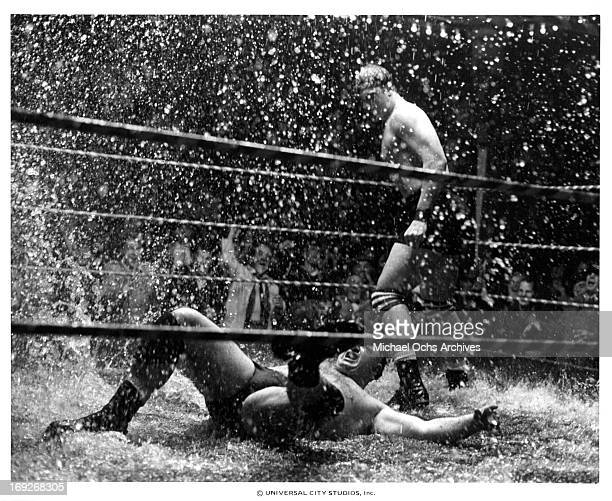 Lee Canalito slams opponent in the rain in a scene from the film 'Paradise Alley' 1978