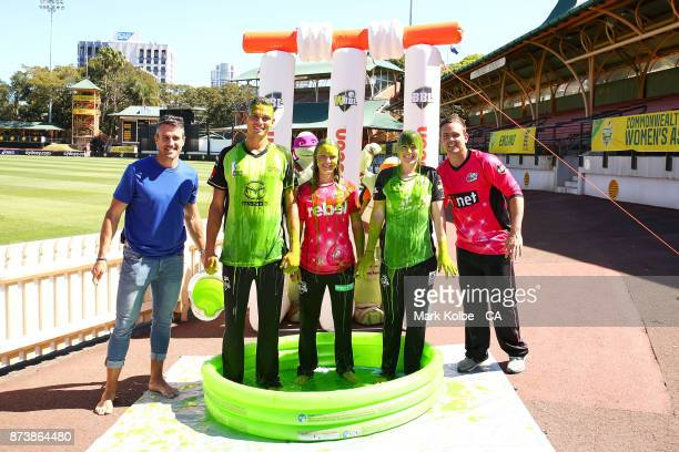 Lee Carseldine Chris Green of the Thunder Carly Leeson of the Sixers Maisy Gibson of the Thunder and Stephen O'Keefe of the Sixers pose after a...