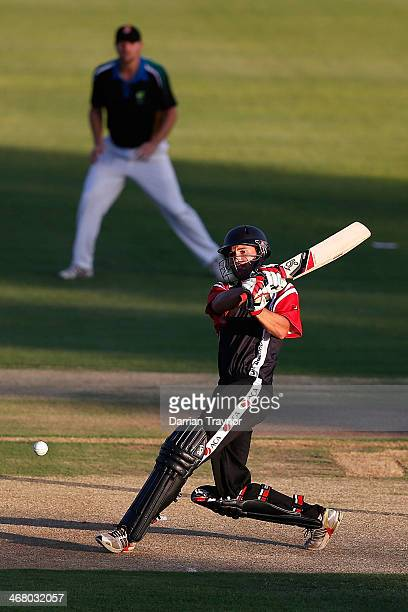 Lee Carseldine of ACA plays a shot during the Imparja Cup match between the Black Caps and ACA at Trager Park on February 9 2014 in Alice Springs...