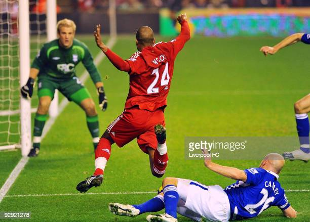 Lee Carsley of Birmingham City concedes a penalty as he challenges David Ngog of Liverpool during the Barclays Premier League match between Liverpool...