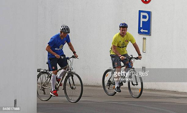 Lee Cattermole and coach Robbie Stockdale head out on a early morning bike ride during a Sunderland AFC preseason training camp on July 9 2016 in Laa...