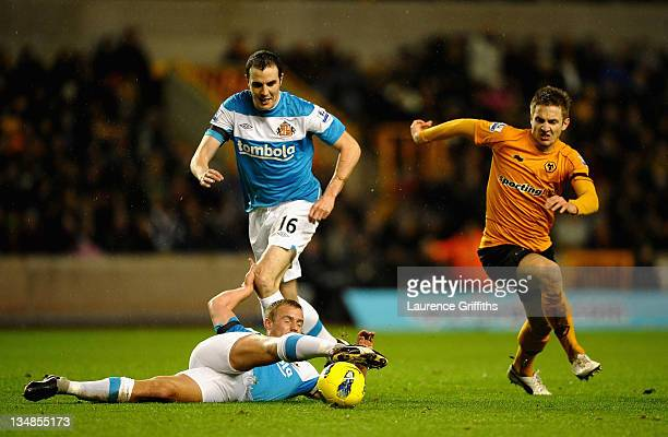 Lee Cattermole and John O'Shea of Sunderland battle with Kevin Doyle of Wolverhampton Wanderers during the Barclays Premier League match between...