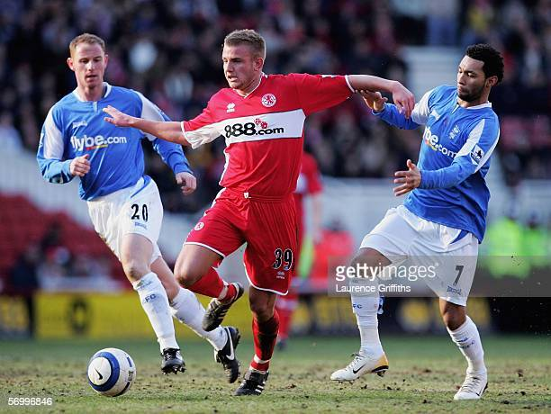 Lee Cattermole of Middlesbrough evades the tackle of Nicky Butt and Jermaine Pennant of Birmingham during the Barclays Premiership match between...