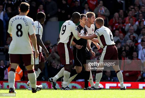 Lee Cattermole of Sunderland appeals to the referee Mr S Attwell as he walks accross the field to consult with his assitant referee after Liverpool...