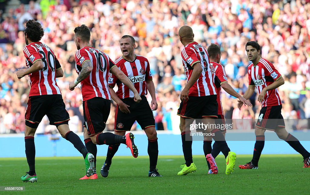 Lee Cattermole of Sunderland celebrates with teammates after Harry Kane of Tottenham scored an own goal to bring the scores level at 2-2 during the Barclays Premier League match between Sunderland AFC and Tottenham Hotspur at The Stadium of Light on September 13, 2014 in Sunderland, England.
