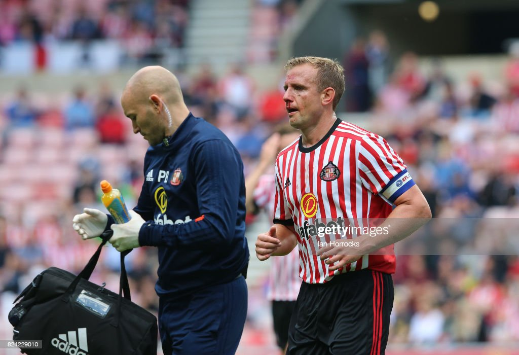 Lee Cattermole of Sunderland goes off injured during a pre-season friendly match between Sunderland AFC and Celtic at the Stadium of Light on July 29, 2017 in Sunderland, England.