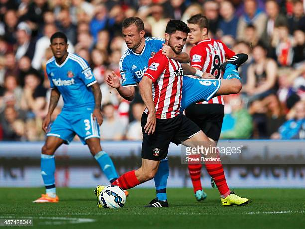 Lee Cattermole of Sunderland grabs Shane Long of Southampton during the Barclays Premier League match between Southampton and Sunderland at St Mary's...