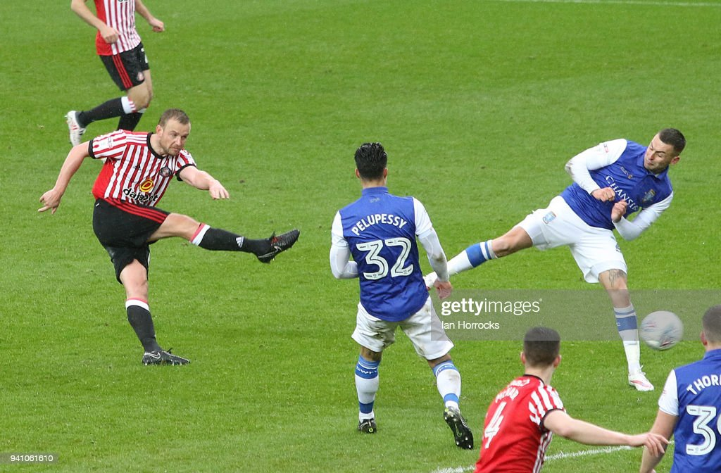 Lee Cattermole of Sunderland (L) hits the post with a shot during the Sky Bet Championship match between Sunderland AFC and Sheffield Wednesday FC at Stadium of Light on April 2, 2018 in Sunderland, England.